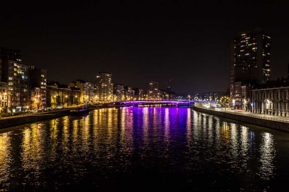 Lights from the Pont Kennedy reflects over the waters of the river Meuse, Liege