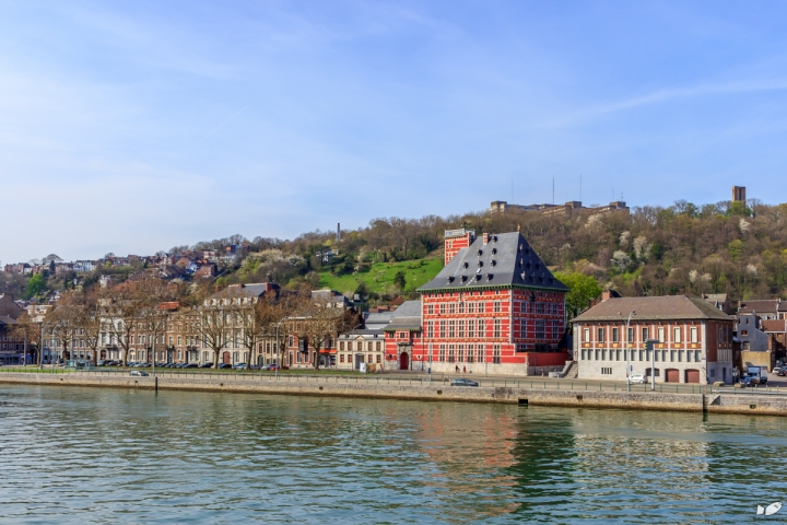 The Grand Curtius standing prominently along the river Meuse.