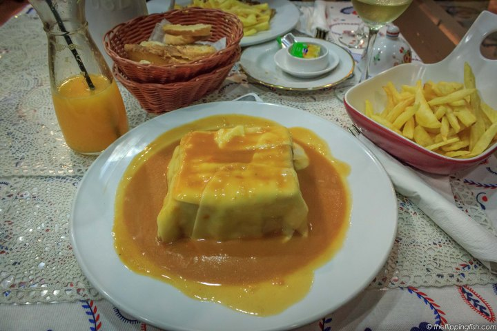 Francesinha, little Frenchie or Frenchie in Portuguese, is a sandwich that originated in Porto.